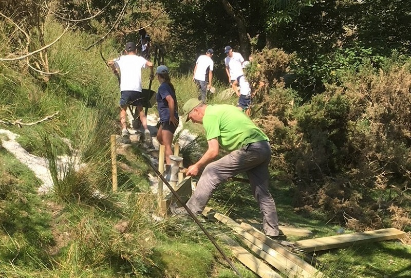 Sedbergh School pupils and a Dales Volunteer work on the Adam Sedgwick Geological Trail near Sedbergh