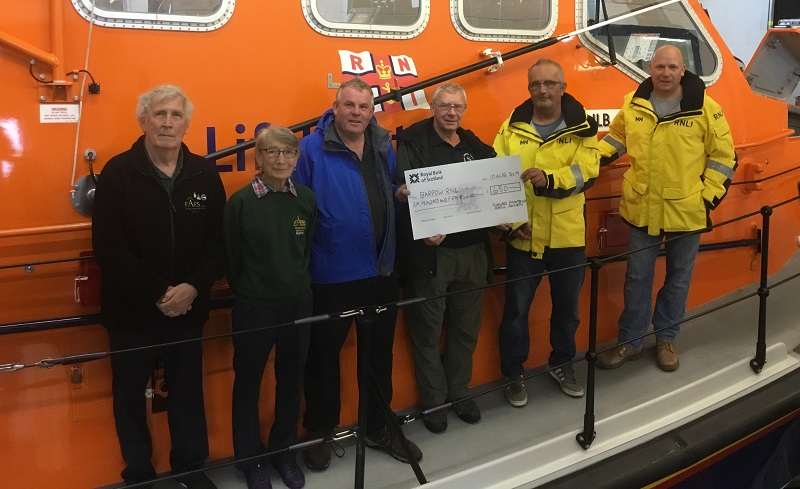 L-R: Bill Jenkins, Audrey Hannan, Les Bell and Dick Smith from the Society, handing over the cheque to Coxswain Shaun Charnley and 2nd Coxswain Jonny Long.