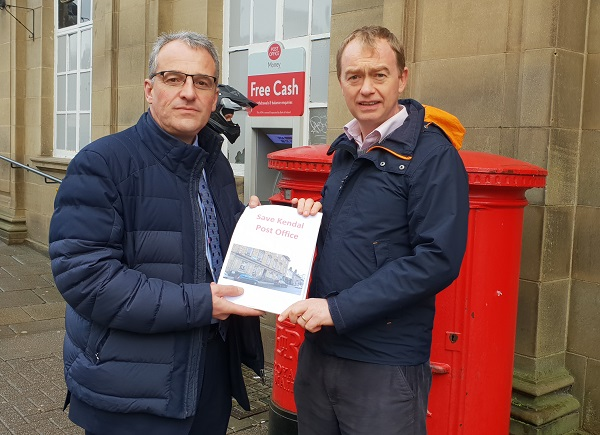Tim Farron MP with Richard Hall, External Affairs Manager at Post Office Ltd handing over the petition