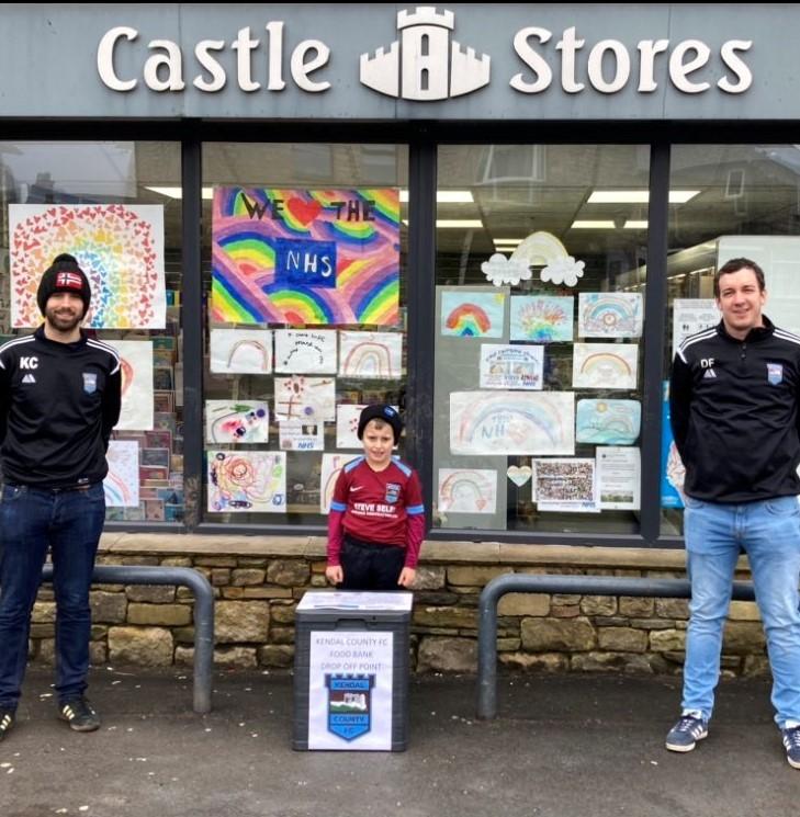 Kris, Harrison (mascot), and Dan  with food bin outside Castle Stores