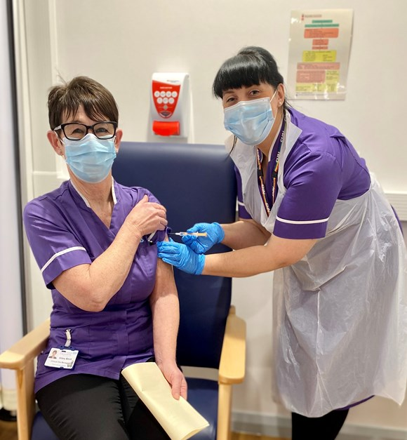 Hilary Birch, the first person at UHMBT to be given the Oxford vaccination, with Matron Clare Hill at the Royal Lancaster Infirmary
