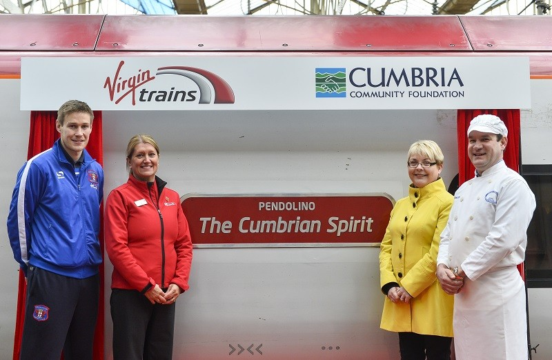 Andrew Hunter of Grasmere Gingerbread (far right) at the unveiling of 'The Cumbrian Spirit'