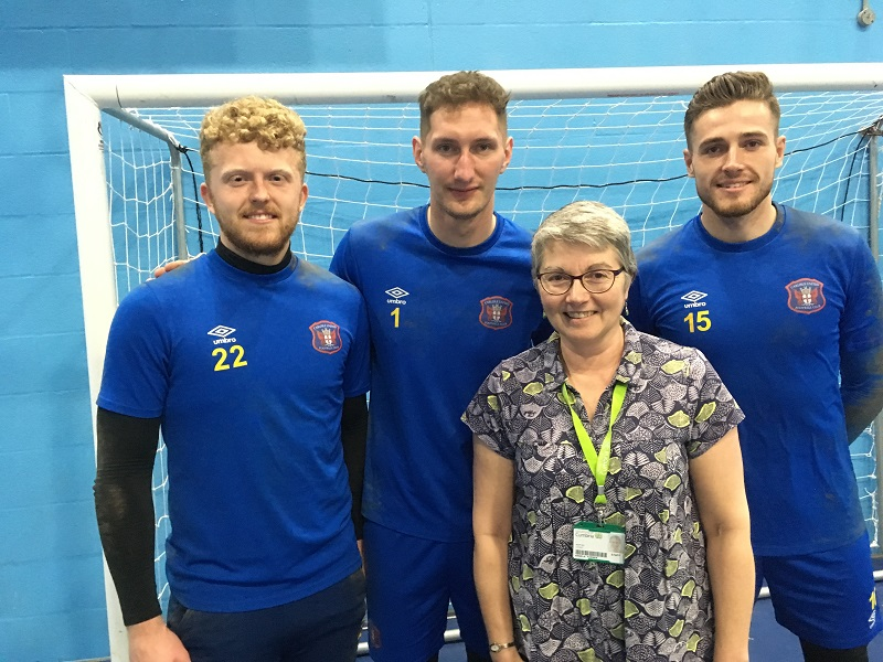 Finance assistant Angela Turner with (L-R) Morgan Bacon, Jack Bonham and Louis Gray.