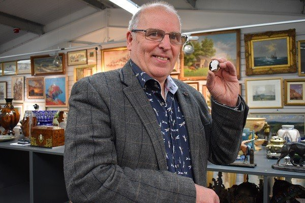Bill Nelson from 1818 Auctioneers with a cameo brooch that sold for £17,200. (Photo 1818 Auctioneers)