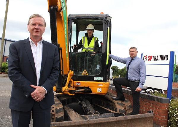 L-R: Tony Higgins (SP Training managing director), Harry Mason (apprentice) and David Kirkup (SP Training construction training manager)