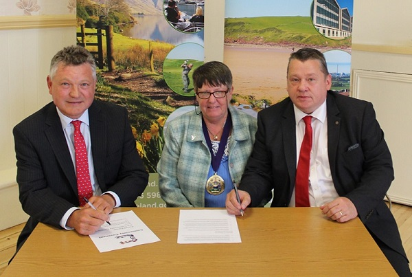 Mike Starkie, Joan Hully and Allan Forster of Copeland Council, re-signing the Armed Forces Covenant