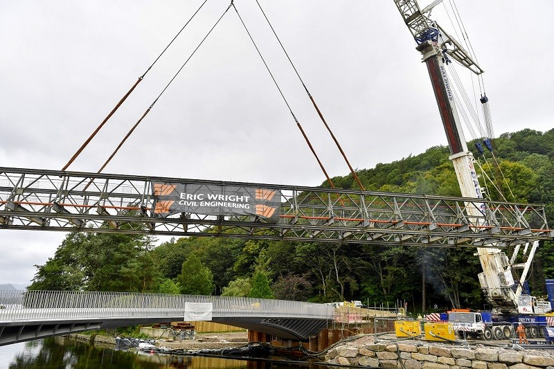 The temporary footbridge over the River Eamont at Pooley Bridge is lifted out (photo Stuart Walker)