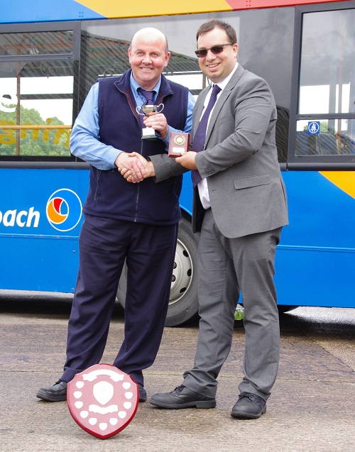 Bus driver of the year David Hind receives his trophy from David Lee-Kong Operations Director for Stagecoach.