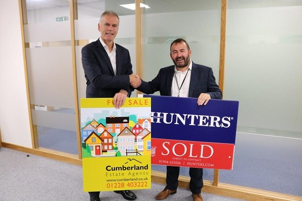Des Moore (left), Cumberland Building Society CEO, and Graeme Macleod, owner of the new Hunters Cumbria, South West Scotland and Lancaster franchise.