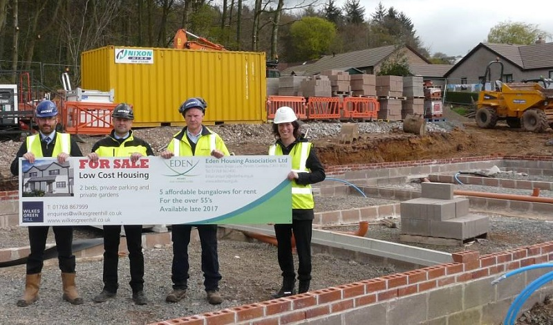 Richard Butcher, Managing Director Ashcroft Construction Cumbria Ltd and their Contracts Manager Robert Copeland and Site Manager Alex Benn with Rebecca Field, Development Manager for Eden Housing Association.