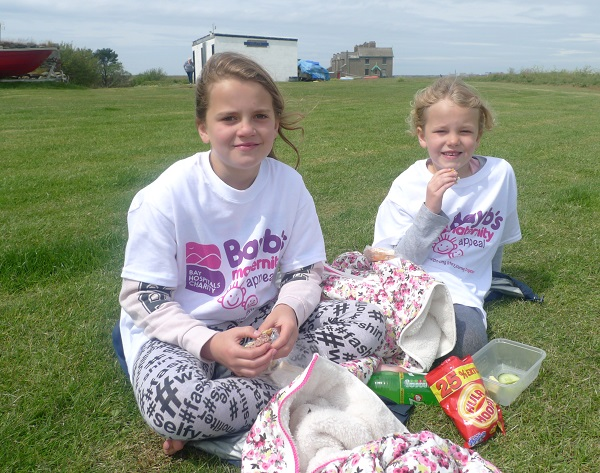 Enjoying a well-deserved rest on Piel Island are nine-year-old Ellie and seven–year-old Rebecca Holland, of Bentham