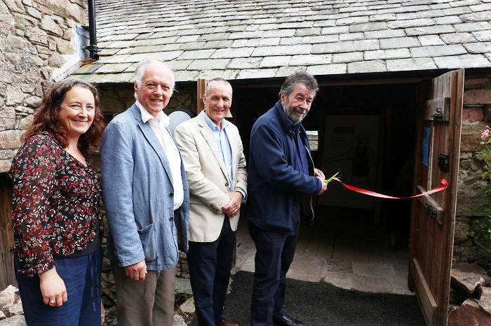 L-R Kate Hughes Mill Manager, Paul Pharaoh Chair of Trustees Eskdale Mill & Heritage Trust, John Williams National Lottery Heritage Fund, Eric Robson President of Cumbria Tourism
