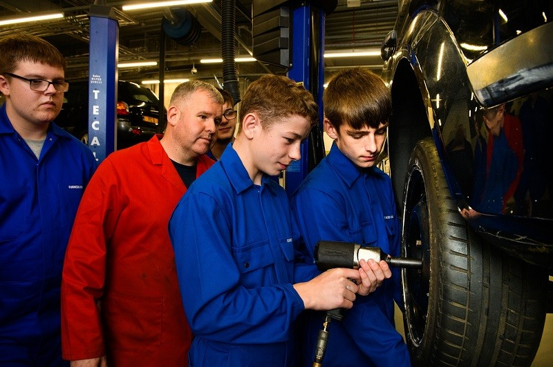 L-R: Mason Smith, motor vehicle tutor Shane Rothery, John Woodward, Harvey Locke and Jaiden Cammock learning skills as part of the Level 1 Engineering Technology Course that the pupils are studying while at school.