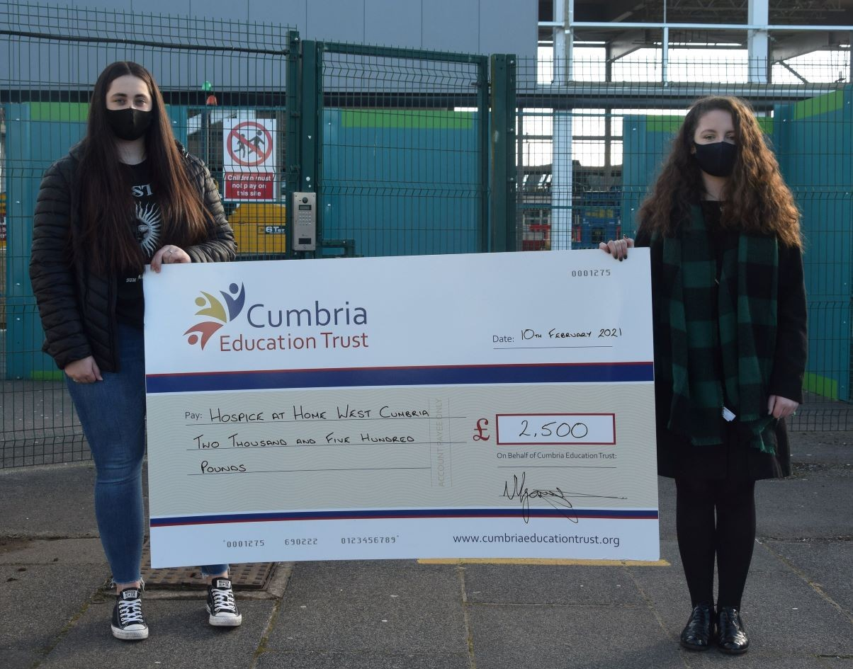 Former The Whitehaven Academy Year 11 students Caitlin Miller and Carenza Curwen with the charity cheque