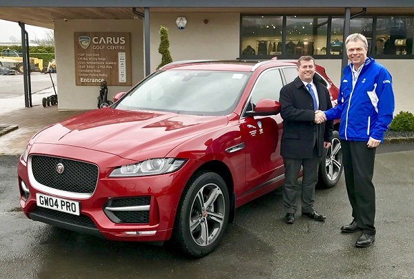 Kenny Curran from Kentdale (left) presenting a new Jaguar F-Pace to Gary Wolstenholme MBE (right)