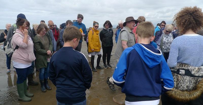 John Murphy (centre) regales walkers with Piel Island tales