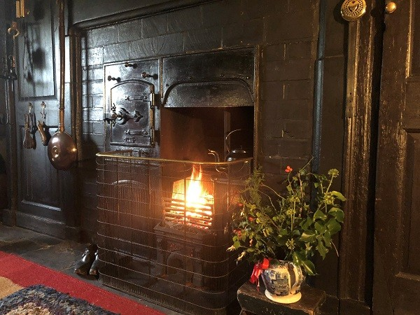Hill Top house - festive fire in the kitchen. Copyright National Trust