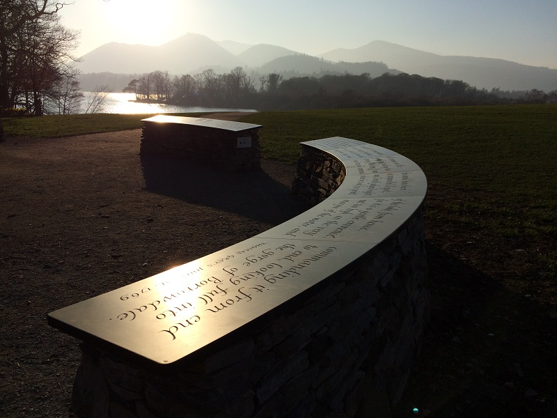 Sun setting on the Honister slate World Heritage Site Plaques at National Trust's Crow Park in Keswick