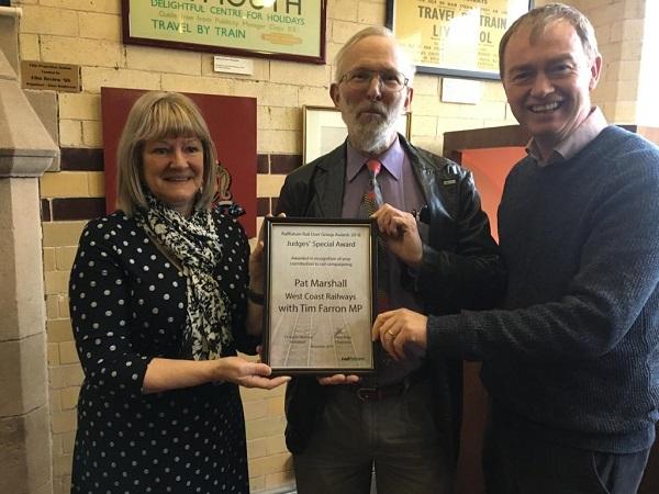 Tim Farron MP alongside Patricia Marshall, managing director of West Coast Railways, and Roger Blake from Railfuture.