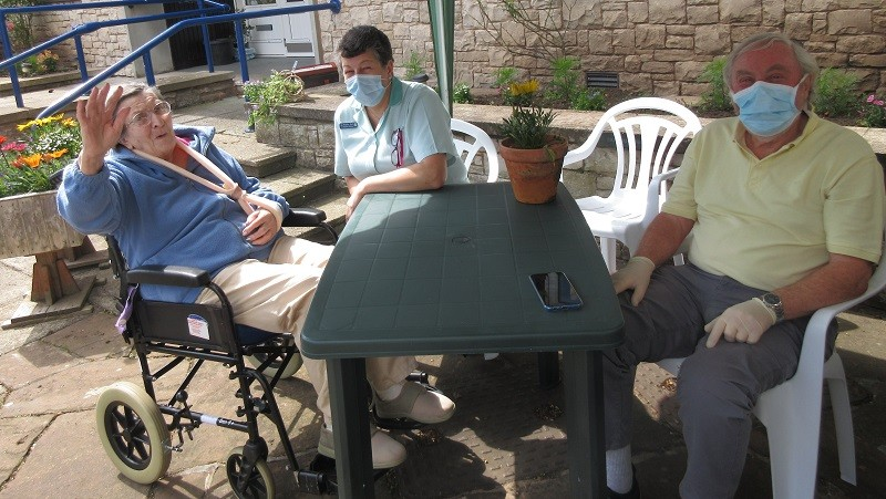 David Prince visiting his wife Kathleen at Christian Head Care Home in Kirkby Stephen. Also in the photograph is support worker Angie Earl. (Note Mrs Prince is not wearing a face mask for medical reasons).