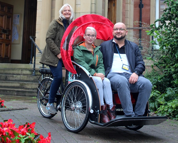 Gaudium Staff outside Penrith Town hall on demo trishaw