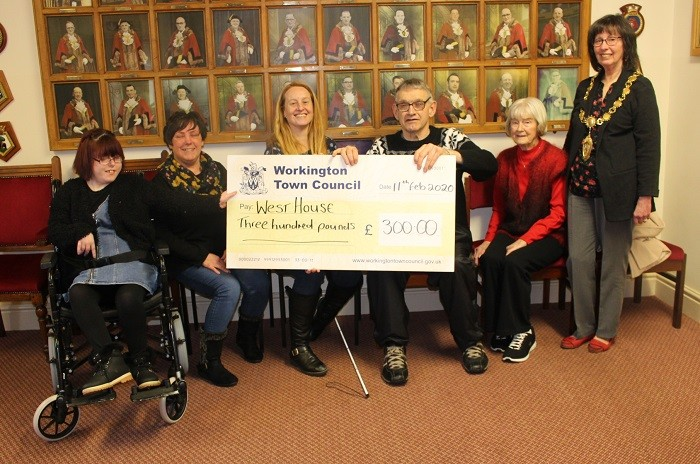Cheque presentation made by The Mayor of Workington to West House