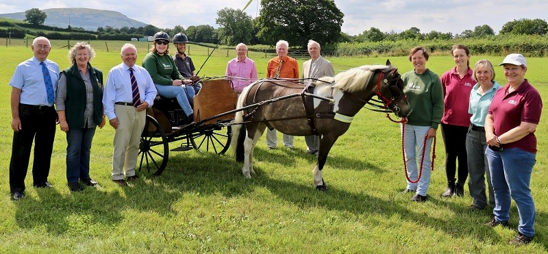 L-R: Brian Ferrington South Westmorland Group Communication's Officer and member of Flowerden Chapter, Annette Poulsom RDA Trustee, Robin Pearson South Westmorland Group Chairman and First Principal of Flowerden Chapter, Lauren Mackereth young driver under instruction, Jenny Harris RDA Carriage Driver Instructor, William Douthwaite, Alan White & David Holland (All members of Flowerden Chapter), Monty the pony, Angie Fordham RDA helper, Josie Sanderson RDA Fundraiser, Shirley Martin RDA Trustee and Carolyn Holden RDA Trustee and group organiser. (Photo Brian Ferrington)