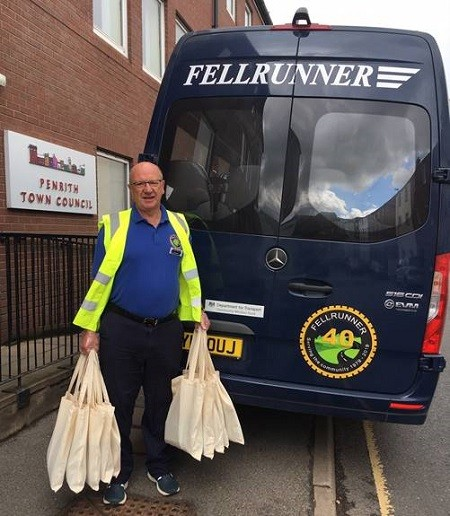 Jim Sisson, volunteer Driver with Fellrunner loading up the last of the bags for delivery