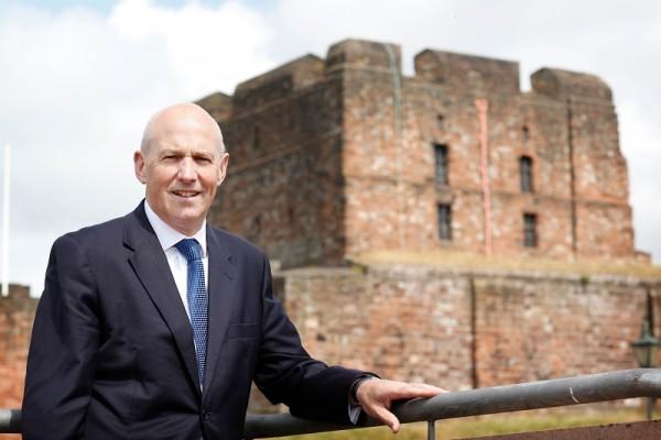 John Stevenson standing outside Carlisle Castle