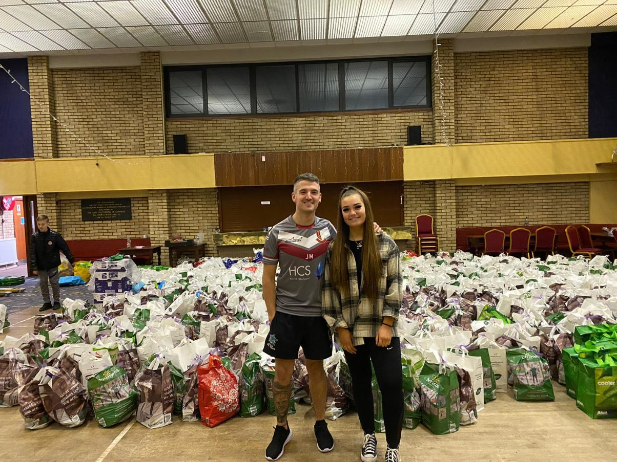 Jordan Mattinson founder of the Copeland Christmas Food Project pictured with friend Beth McGregor and some of the bags of food