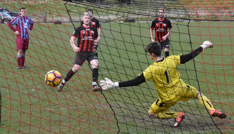 Karl Southern puts Keswick 4-0 up against Kendal County from the penalty spot (Ben Challis)