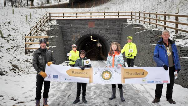 L-R: Richard Leafe, Chief Executive of the Lake District National Park, local school children Monty and Holly and Keswick Mayor, Paul Titley, officially opening the new Keswick to Threlkeld Railway Trail with trail users, Keith and Sally Lunsen watching on.