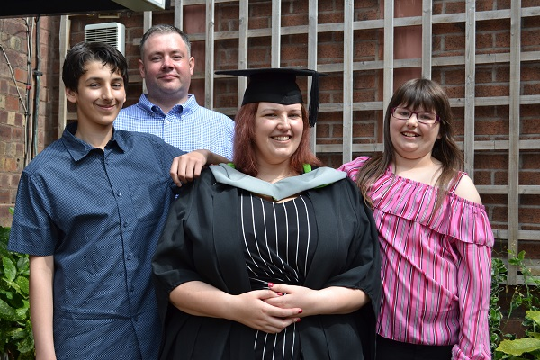University of Cumbria social work graduate Kimberley Jones (front) surrounded by son Jack, partner Mark and daughter Alexa following her ceremony at Carlisle Cathedral