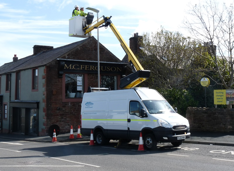 An LED street light being fitted on Brunswick Road in Penrith.