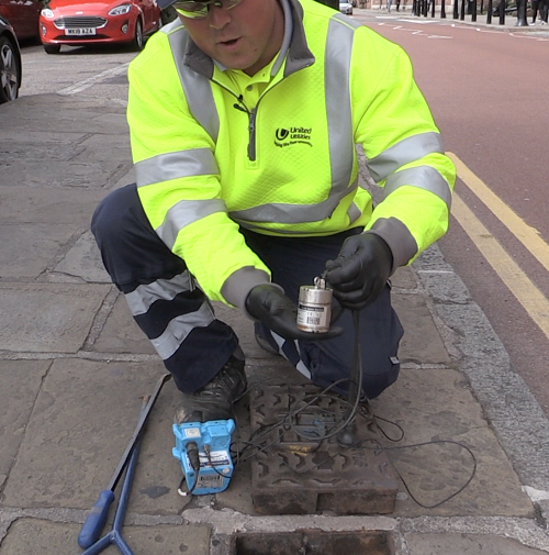 United Utilities leakage technician, Arran Pullen, installs one of the new acoustic loggers.