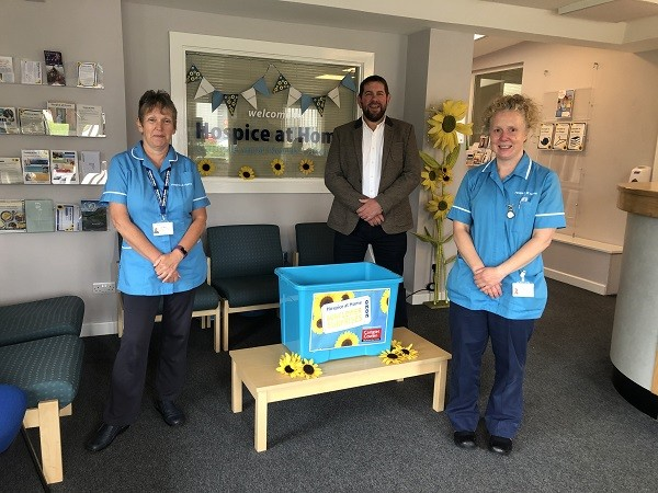Linda and Susie (Hospice at Home Lymphoedema Team) with Richard Percival from Carigiet Cowen draw the Sunflower Surprises Raffle
