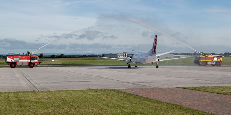 Loganair Saab 340 gets water cannon salute at Carlisle Airport launch