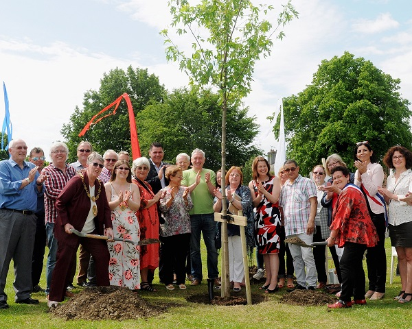 A tree planting ceremony was the main event, celebrating 20 years of friendship. Left the Mayor of Workington, Ann Bales, right French Socialist Cllr, Catherine Duvallet from Val De Reuil plant the tree. Present was Sue Hayman, and Barabara Cannon, Centre. (photo Jim Davis)