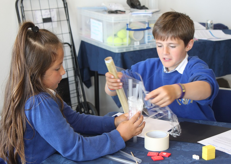 Lucy-Jo Worthington and Derren Lynch, Distington Community School pupils working to together to try and create a boat that can withstand a tsunami
