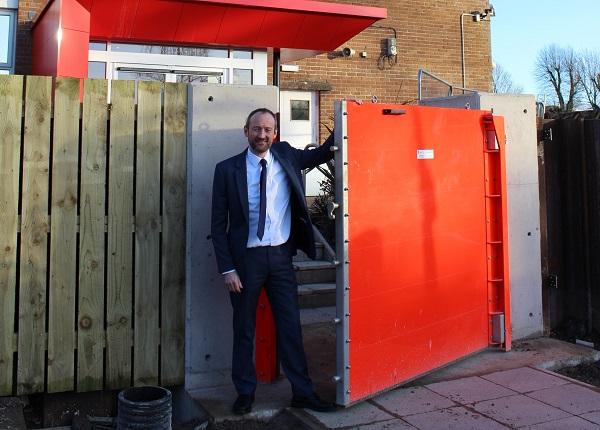 Mark Brook MD at James Walker & Co beside the new floodgate