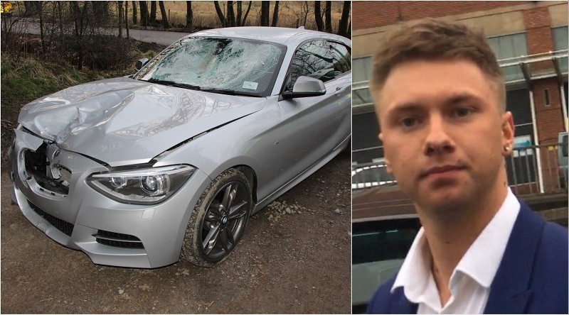 Matthew Leggett and his badly-damaged BMW at the entrance to Setmurthy Woods