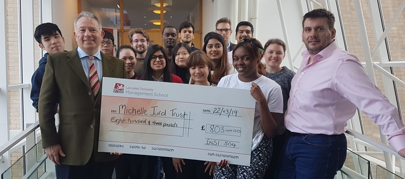 Neil Jurd, founder of the Michelle Jurd Trust, received the cheque for £803 from the students at Lancaster University