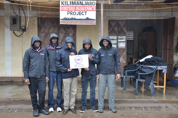 Mount Kilimanjaro Porters testing out their new waterproof jackets