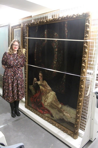 Museum Curator Nicola Lawson with 'Betty' by James Durden, subject of the Museum's 2021 exhibition 'Betty's Back'