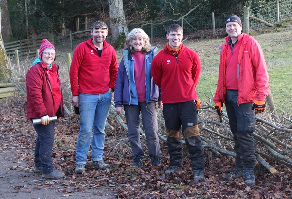 Hedge-laying volunteers, from left, Sarah Dixon, John Crosby and Jackie Poulton, with rangers Jack Deane and Roy Henderson. Picture: National Trust