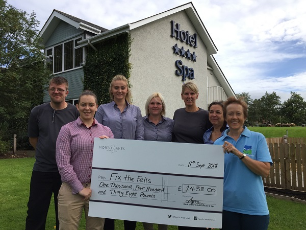 Staff from North Lakes Hotel present the donation cheque to Joanne Backshall of Fix the Fells