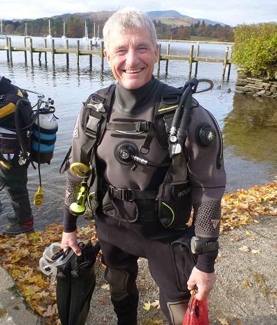 TV presenter and explorer Paul Rose diving litter pick at Windermere