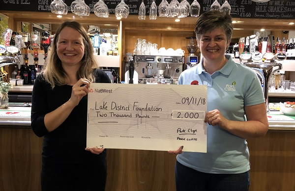 Fix the Fells operations manager Sarah Smith (left) receives the donation from Park Cliffe's Susan Dickson