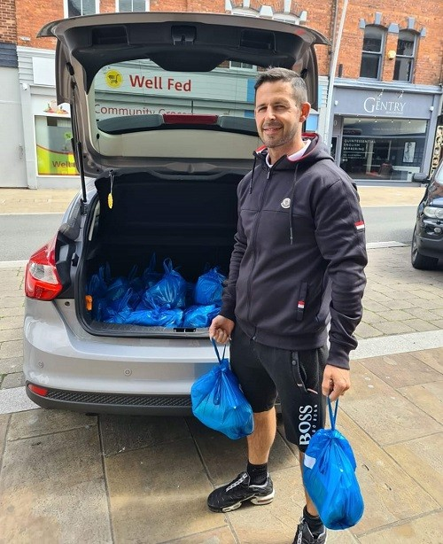 Mark Murphy, a Building Better Opportunities keyworker for The Well Communities, getting ready to deliver Let's Eat food and recipe packs