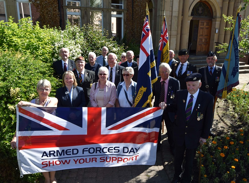 Members of the Royal British Legion and Armed Forces veterans join Eden District Council Councillors to raise a flag for Armed Forces Day 2018.
